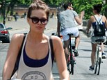 Margot Robbie shows off her slim legs in denim shorts as she enjoys a bike ride with a male friend