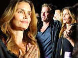 Still so in love! Cindy Crawford and husband Rande Gerber cuddle up in matching outfits on date night at Billy Joel concert
