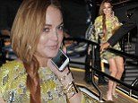 Oh no, not again! Lindsay Lohan almost loses her footing on the same superyacht she took a tumble on in 2010