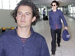 Orlando Bloom catches a flight out of London's Heathrow Airport
