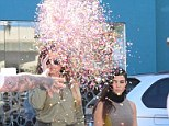 Reports: Kourtney and Khloe Kardashian have denied they filed a battery report against a clown after they were confetti-bombed last month
