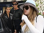 Ramping up the wedding prep! Kim Kardashian's sisters Khloe and Kourtney arrive at her Paris apartment with mom Kris Jenner