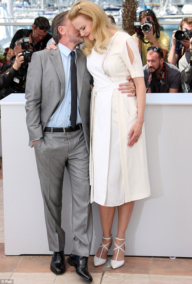 Support: Looking elegant in a cream midi-length frock, the star cosied up to actor Tim Roth at the film's photo call