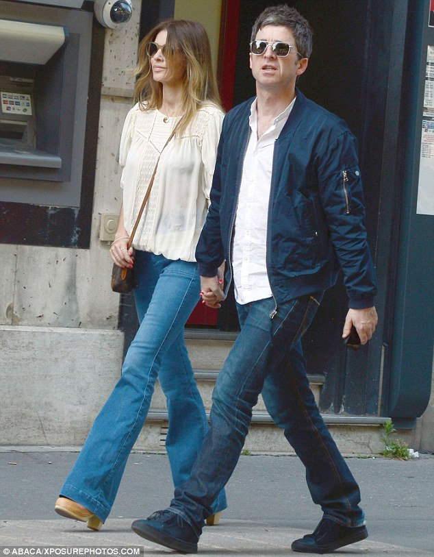 Stand By Me: Noel Gallagher was seen strolling hand-in-hand with wife Sara McDonald down Paris' Avenue Montaigne on Saturday