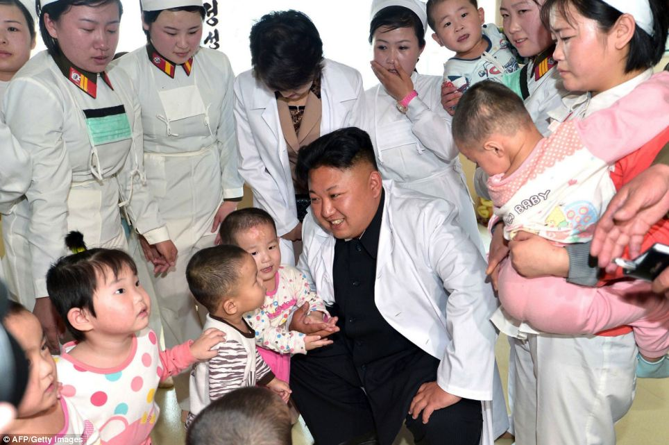 The photos were released today and one of them shows the children trying to get closer to Kim Jong-Un during the visit