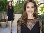 Angelina Jolie stuns in black lace mini dress and horned heels as she attends Maleficent photocall