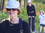 Child at heart! Marcia Cross, 52, rides home via scooter as her seven-year-old twin daughters follow behind