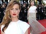 Sultry siren! Amber Heard sends pulses racing in white top and metallic gold skirt at Cannes Film Festival premiere