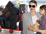 Miranda Kerr looked her elegant self as she and her three-year-old son Flynn jetted out of Sydney on Wednesday with a jaw-dropping 14 suitcases in tow