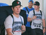 A muscular Mark Wahlberg showcased his bulging biceps as he touched down in Melbourne on Wednesday ahead of the Transformer's Age Of Extinction Australian premiere later than night