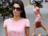 George Clooney's fiancée Amal Alamuddin puts on a leggy display in pretty pink dress for lunch in London