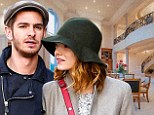 The look of love: Andrew Garfield and Emma Stone hold each other's gaze on NYC stroll as they are rumoured to be splurging £6.2million on love nest