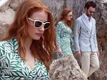 Jessica Chastain looks pretty in print as she steps out hand-in-hand with boyfriend Gian Luca Passi De Preposulo in Cannes