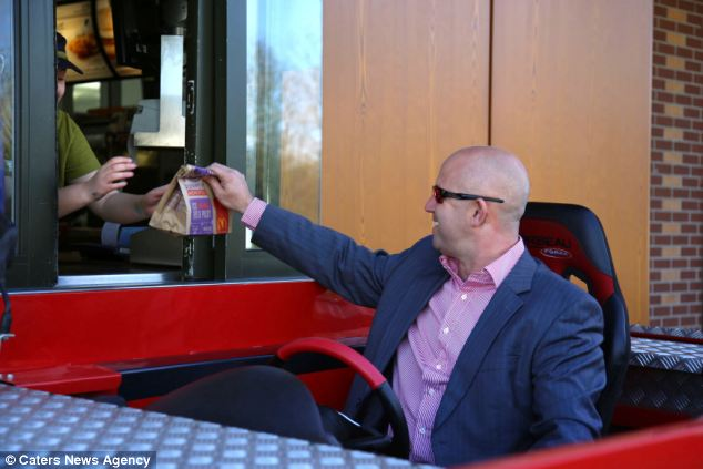 Mr Norvill takes his unusual motor to a McDonald's drive-through restaurant to pick up a meal