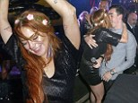 Lindsay Lohan shows off her lithe legs in leather mini dress as she parties the night away with her brother Michael at Cannes VIP room