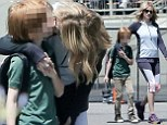Don't embarrass me, mom! Julia Roberts kisses son Phinnaeus, nine, during stroll together as she sports grey work-out gear