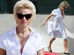 Pamela Anderson looks chic in white shirt dress as she steps out in Cannes... after her mother admits she is 'heartbroken' she couldn't tell her about abuse