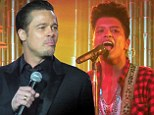 Brad Pitt shakes his tambourine 'Like a Sex Machine' onstage with Bruno Mars at New Orleans gala concert