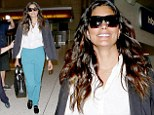 Calm before the storm: Rachel Roy was all smiles as she prepared to jet off to her best friend Kim Kardashian's wedding to Kanye West