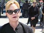 Melanie Griffith steps out in cat's eye sunglasses and stylish black dress which displays her trim figure