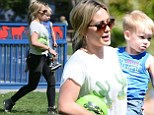 Having a ball! Hilary Duff carries adorable son Luca to the park after stepping out in fun cactus-print T-Shirt and skinnies