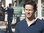 Happy Wahlberg! Mark practises his golf swing at Sydney driving range as he takes a break from his international press tour