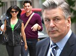 Ruff justice! Alec Baldwin takes the dogs for a walk... while wife Hilaria steps out with strapping young man in New York