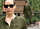 Dressed up for the dog! Liv Tyler wears stylish green bodysuit while enjoying a leisurely stroll with her dog