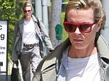 Kim Basinger, 60, rocks casual grey on grey for business meeting in Century City