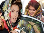 Brightening up the streets: Cindy Crawford and her lookalike daughter Kaia got caught in some drizzle on Wednesday in Paris, such that both covered themselves with exotic silk headscarves
