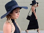 Stepping it up: Vanessa Hudgens stepped out in a slinky backless black gown with a derby hat for a lunch date at The Village restaurant in Studio City, Los Angeles on Wednesday