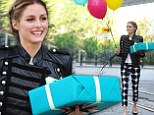 She's walking on air! Olivia Palermo shows her dotty side while heading to a birthday bash bearing gift and balloons
