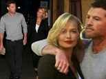 Stay close: Lara Bingle gets an affectionate cuddle from her boyfriend Sam Worthington as the pair stood on the street after she held an event at Cotton On USA in Santa Monica, Los Angeles on Tuesday night