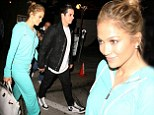 Jennifer Lopez steps out hand-in-hand with Casper Smart as she ditches screen glamour for aquamarine tracksuit and fluffy boots