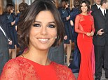 Eva Longoria ramped up the glamour for the second day in a row, arriving at a party in a stunning red gown with matching lace panels.