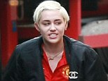 Lady in red: American singer Miley Cyrus was spotted in Birmingham wearing a Manchester United shirt