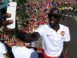 On his way: Bacary Sagna, taking a selfie during Arsena;'s trophy parade on Sunday is set to join Manchester City