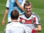 All smiles: Toni Kroos, in training for Germany on Thursday, believes he will be at Bayern Munich next season