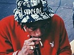 Not learning his lesson? Wiz Khalifa posts picture of himself smoking a suspicious-looking roll-up on Monday after being arrested for possession of marijuana