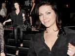 Black is back! Laura Prepon wows in figure hugging leather trousers and plunging blouse for dinner in Hollywood
