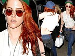 A tuckered out Kristen Stewart arrives into LAX wearing a trucker cap after her whirlwind tour at Cannes