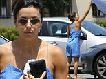 No need for a mechanic! Eva Longoria gets her hands dirty and inspects her car's engine in floral blue dress