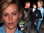Still going strong: Charlize Theron and boyfriend Sean Penn jet out of town with her two-year-old son Jackson