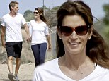 The look of love! Cindy Crawford is starry eyed over her husband Rande Gerber as they hike together hand-in-hand