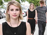Feeling the spirit! Emma Roberts gets into character for American Horror Story and sports witch-inspired outfit with Evan Peters