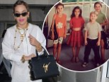 Rita Ora shows off her natural brunette locks in sweet childhood snap... as she steps out with new braided hairstyle