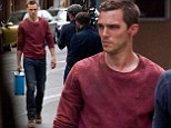 His Skins doesn't look good! Nicholas Hoult steps out in ripped clothes and covered in cuts as he films thriller Autobahn in Germany
