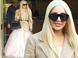 Feeling like a royalty! Lady Gaga wears pink princess-inspired dress after taking a break from ArtPop Ball tour