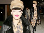 All aboard: Rita Ora wore a 1930s train driver chic hat as she arrived back in London from Radio 1's Big Weekend in Glasgow