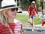 Naomi Watts shows off her toned legs in mini denim shorts as she spends Sunday with Liev Schrieber and the boys